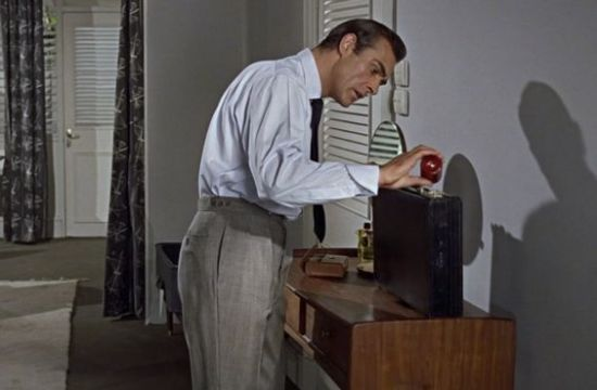 Sean Connery as James Bond, wearing trousers with vertical pockets.