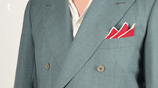 Bright red pocket square with white contrasting edges