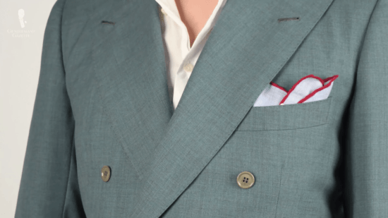 Light blue pocket square with red edges