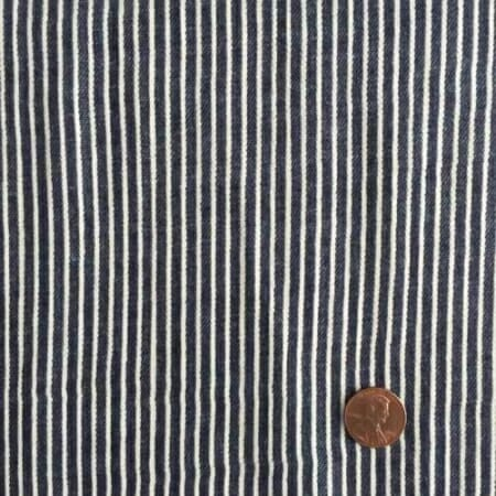 Railroad stripe fabric, with penny included to show the size of the weave.