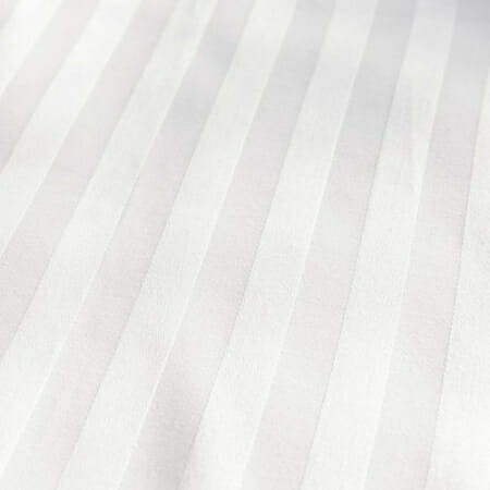 Satin stripes in white, presented at an angle to show how light affects the design.