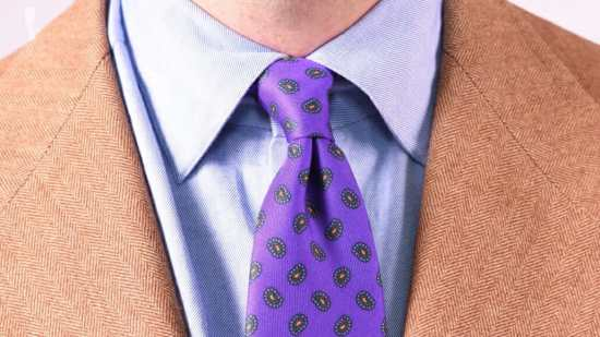 A blue dress shirt with purple paisley tie from Fort Belvedere
