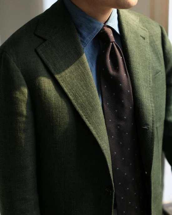Denim shirt with green jacket and brown tie