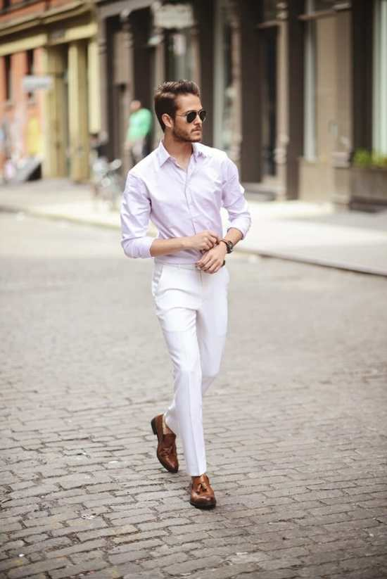IAmGalla pairing a tucked in subtle pink shirt with white pants