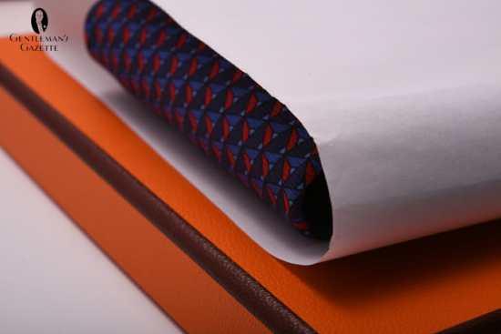 Orange Hermes tie box with brown edges