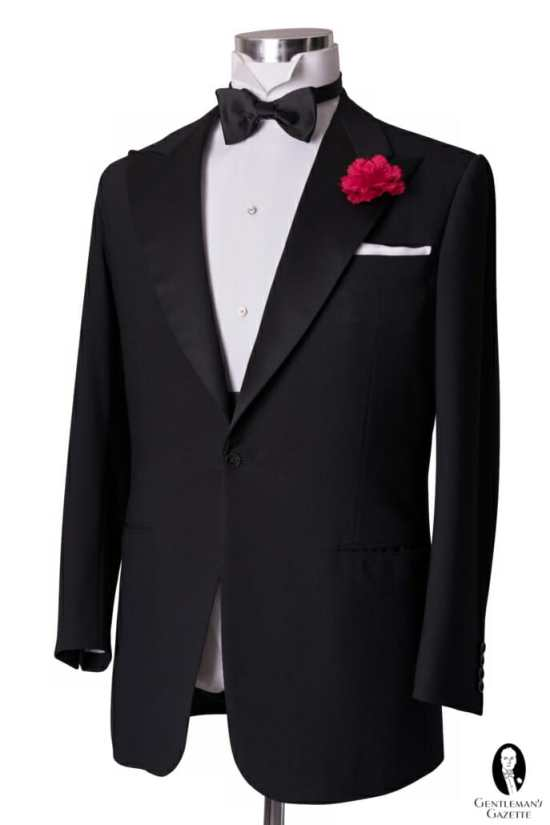 The most traditional model of tuxedo jacket: black and single-breasted with one closing button, peaked lapels with silk facings, and no rear vents.