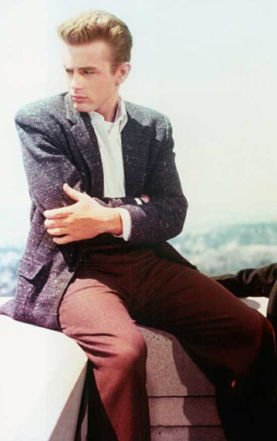 James Dean in Rebel Without a Cause, wearing a sports coat, odd trousers, and collared shirt.