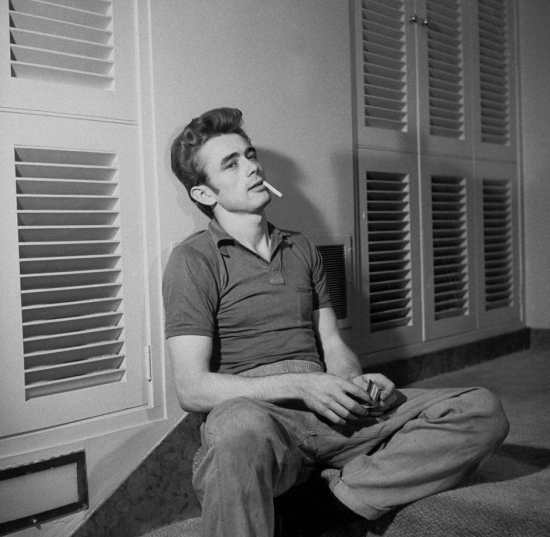 James Dean in a polo shirt and jeans.