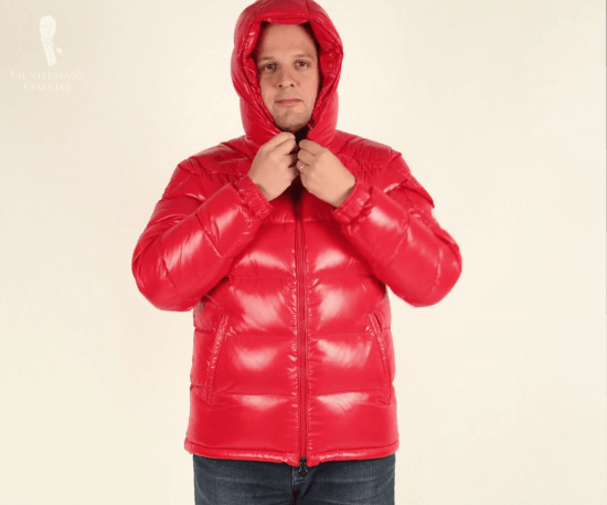 SRS wearing a red Moncler jacket