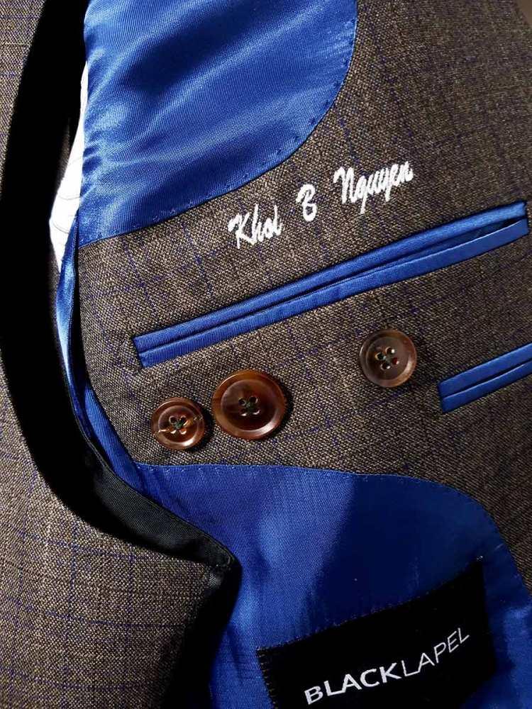 black lapel suit details