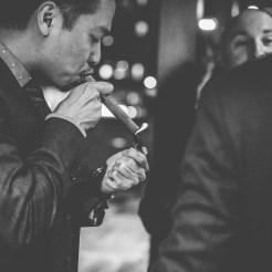 gentleman lighting cigar