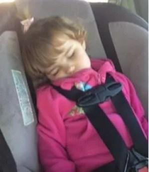 toddler sleeping wearing seat belt in booster seat