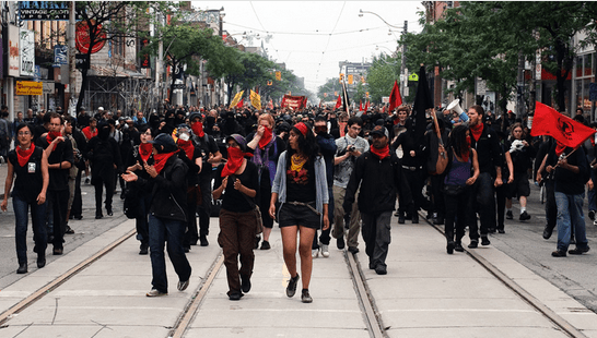 NoII leading the Black Bloc anarchists at the G20