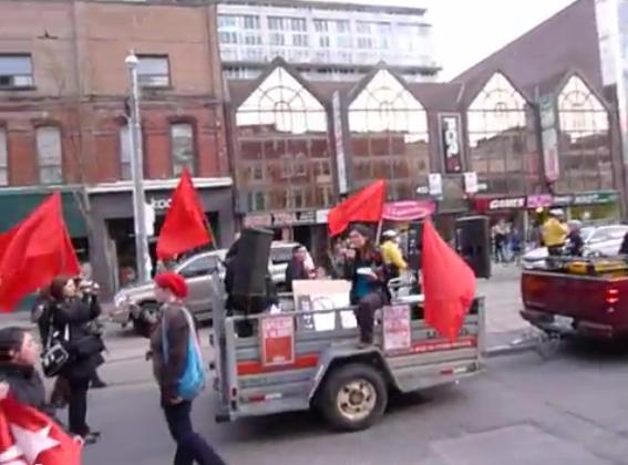 Sakura Saunders leading Marxist revolutionary chants at last year's May Day rally.