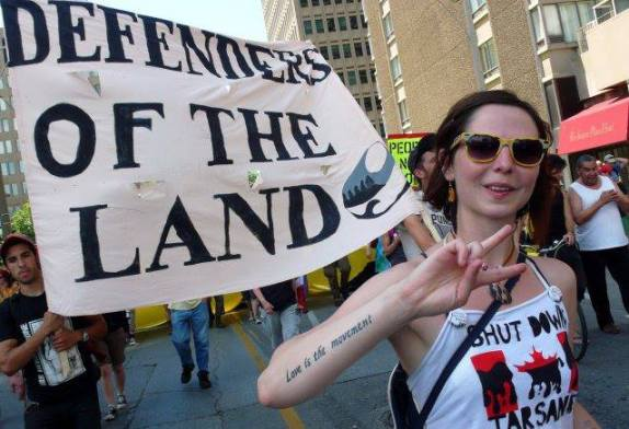 Sierra Club exec Chelsea Flook's Love Is The Movement tattoo...