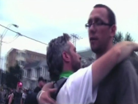 Dave Vasey (left) hugging Adam MacIssac as the later is being released from G20 detention centre