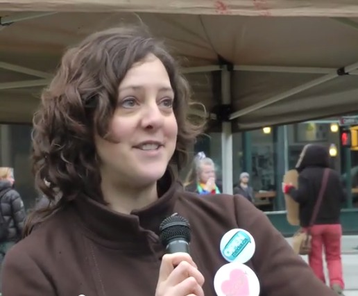 Sarah Buheler, wearing her Occupy Vancouver & OpenMedia pins