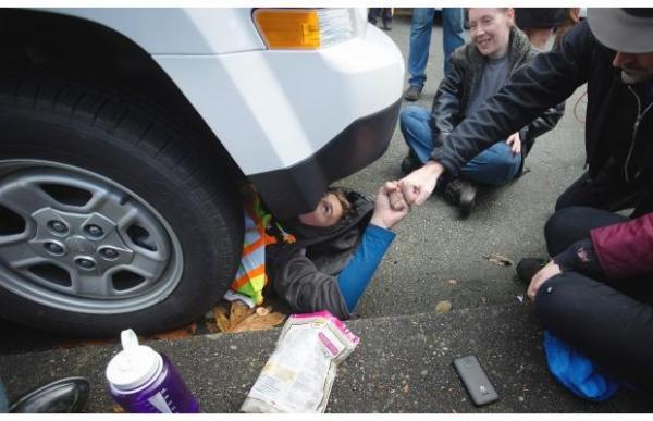 Jakub under a Kinder Morgan truck...