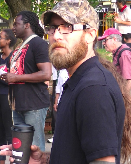 "Anti-capitalist Alex Hundert ""Lovin' It"" with McDonalds coffee"