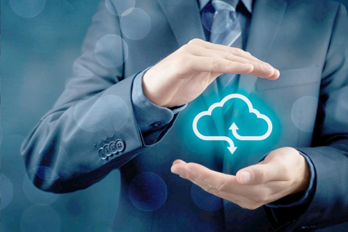 Man holding graphic of cloud computing