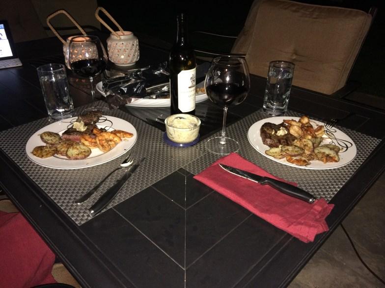 Rib Eye Steak, Jumbo Shrimp, Parmesan Crusted Potatoes, and a nice bottle of wine.