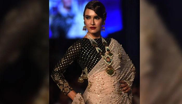 Model Nadia Hussain wears a dress by designer Aamna Aqeel. Photo: AFP