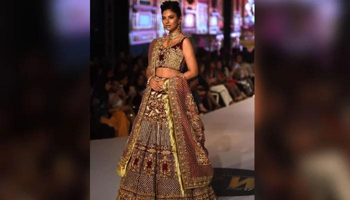 Model Sunita Marshal walks in ramp in a dress designed by Erum Khan. Photo: AFP
