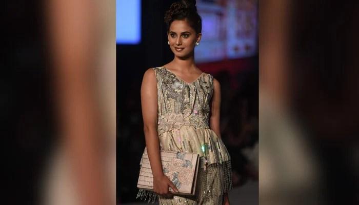 Designer Erum Khan's dress being showcased on the ramp. Photo: AFP