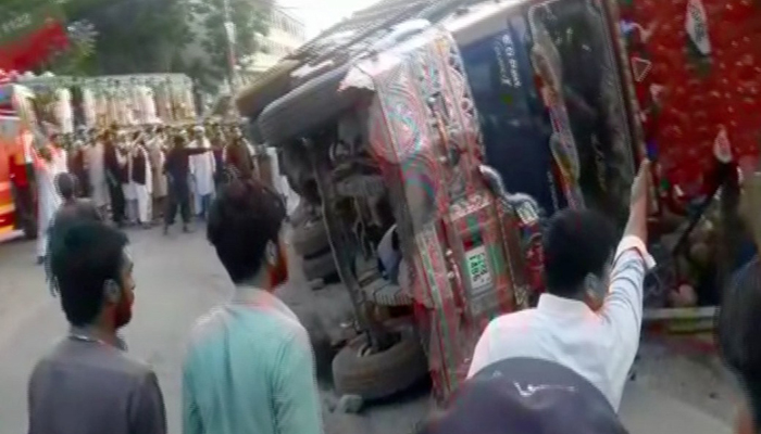 A truck crushed a van after the latter tried to overtake it from the wrong side here on Thursday, May 10, 2018. Photo: Geo News
