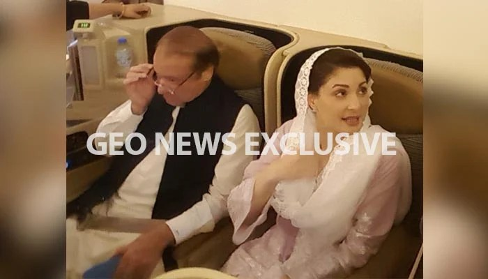 Nawaz Sharif and Maryam Nawaz on the flight headed from Abu Dhabi to Lahore. Photo: Geo News