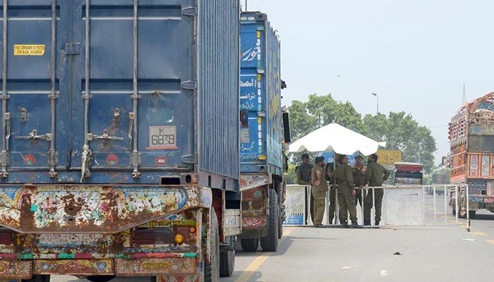 Containers parked at Band road in Lahore. Photo: Online