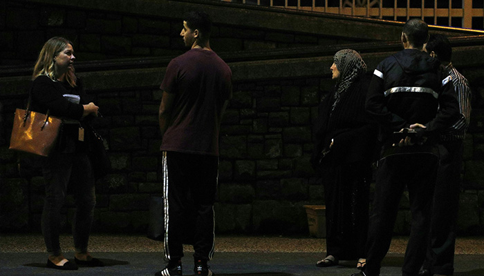 Members of the Muslim community wait outside a hospital after a shooting incident in Christchurch. PHOTO: AFP