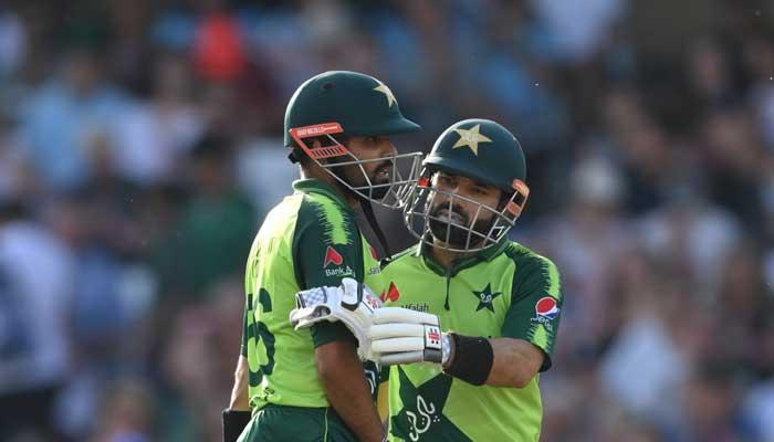 Mohammad Rizwan congratulates Babar Azam during the first T20 against England.