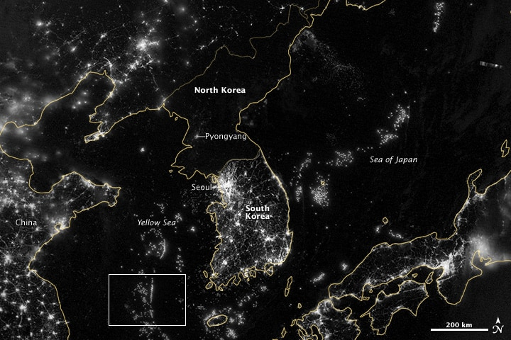 An updated higher resolution image (September 24, 2012) captured by the the Visible Infrared Imaging Radiometer Suite (VIIRS) on the Suomi NPP satellite shows in more detail the darkness of North Korea at night. More about the Map of the Earth's Night Light.