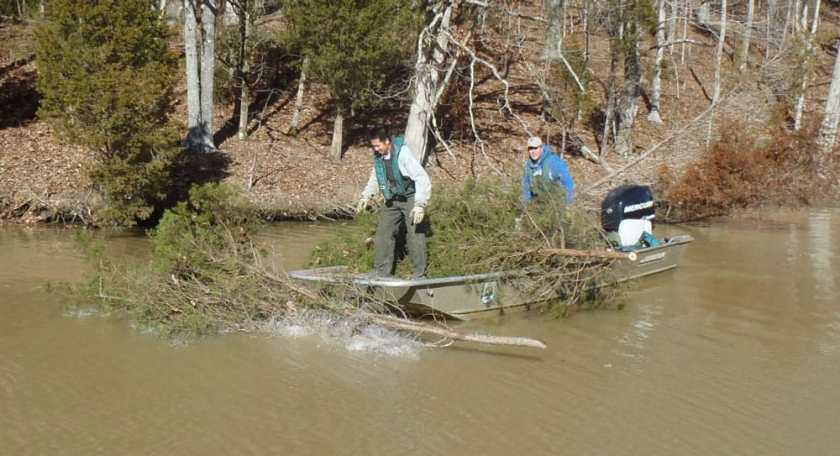 The Kentucky Department of Fish and Wildlife resources submerges fish into lakes to built fish habitat.