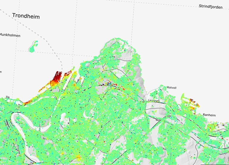 InSAR data for the Trondheim harbor area. Green are areas with no movement, yellow and red points are areas that are moving about 1 cm/year in the residential areas and 2 cm/year along the harbor. Source: Geological Survey of Norway.