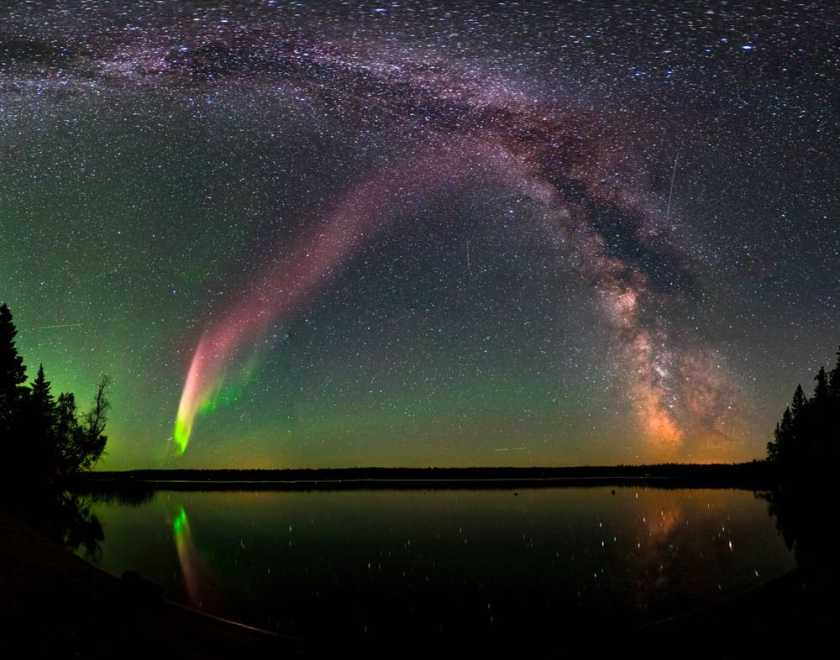 STEVE (Strong Thermal Emission Velocity Enhancement) and the Milky Way at Childs Lake, Manitoba, Canada. Image:  Krista Trinder/NASA, public domain.