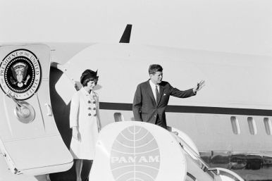 """President John F. Kennedy and First Lady Jacqueline Kennedy depart Air Force One upon their arrival at Isla Verde International Airport. San Juan, Puerto Rico."""