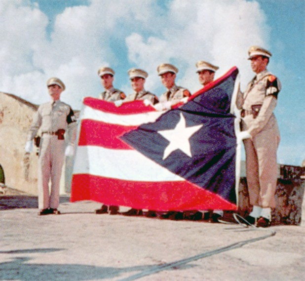 Officially adopted in 1952 as the symbol of the Commonwealth of Puerto Rico, this flag was designed by a group of patriots in 1895. Today it is commonly flown side by side with the Stars and Stripes.