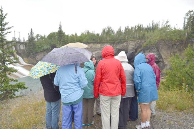 Pouring rain does not deter the AWG field trip discussions.