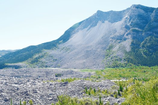The Frank Slide, located east of the towns of Coleman and Blairmore, Alberta, in the Crowsnest Pass area. The slide occurred on 4/29/1903. when 82 million tons of limestone fell off Turtle Mountain, burying part of the town of Frank, Alberta.