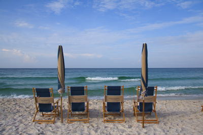 beach chairs and wave
