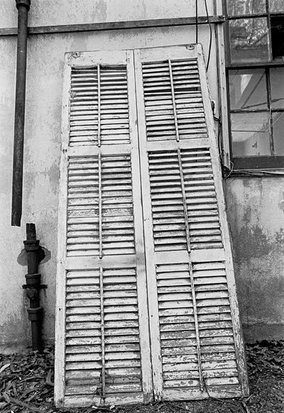 old shutter outside an abandoned house
