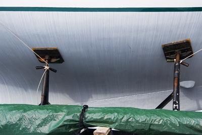 boat with green tarp
