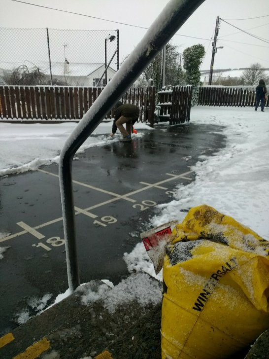 Playground being cleared and gritted by my children on Sunday!