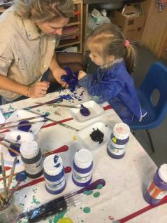 Stepping Stones painting their poppies...