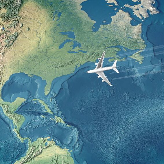 5389946 - white civil airplane over the atlantic ocean flying to the usa
