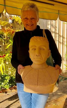 Dale taking her completed sculpture home, it fired up very well