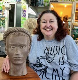 Jacqueline during the art class has just completed her first sculpture of a head