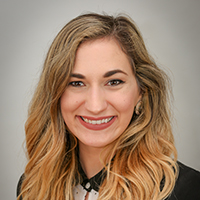 Close headshot of Anne Chaplin, Program Coordinator at the UGA SBDC in Albany. She has long blonde hair that gets lighter towards the bottom.
